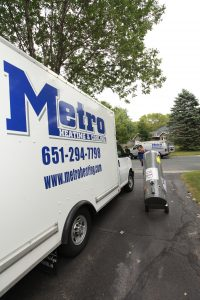 Metro Heating and Cooling truck on a customer's driveway